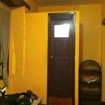 View of door to mini bathroom inside room.