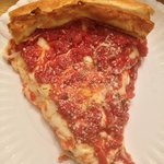 this is a slice of the deep dish. take out of course because this is a take out only pizzeria.