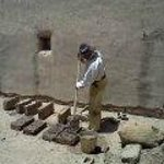 "A ""laborer from Taos"" making bricks"