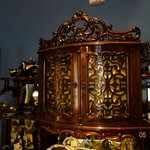 A closeup of the top of the ornate breakfront in the dining room.