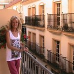 A balcony room facing Calle Capitan