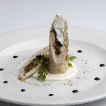 Rolled chicken with rocket salad, mozzarella, dry fig in gorgonzola cheese sauce