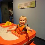 The infant seat in the water table