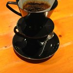 Joe serves filter coffee with the filter left on. In another a nice touch, all the tables have n
