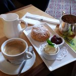 An afternoon snack - fabulous coffee, and scone with cream and jam