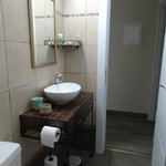 Bathroom, amenities in the shelf, hair dryer provided