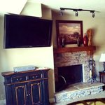 Flat screen and fireplace in living area
