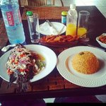 grilled tilapia, joloff rice, fried spicy plantain and fresh passion fruit juice