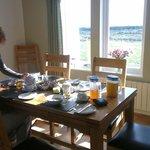 Rachel serving breakfast to the guests