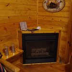 Fireplace in Living/Dining Room on Deluxe Cabin DK3