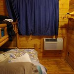 Bedroom in Deluxe Cabin DK3 (Full Bed under Single Bunk, Bathroom to the right. Shower only, No