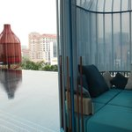 """Fantastic pool """"pods"""" with infinity pool looking across the city streets."""