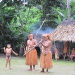 Yagua village leader demonstrating blow gun