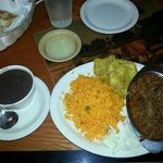 Ropa with yellow rice, tostonies, black bean soup and mojo