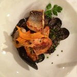 three fish on black ink risotto with mussels