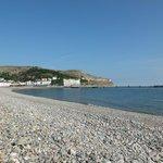 Shingle beach and pier