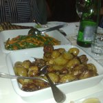 Side helpings of roasted potatoes and veg.