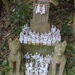 fox figures on a small stone shrine
