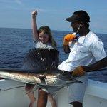 Sarah catching her first sailfish