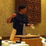 Chef Ming demonstrating how to cook fish in wasabi oil.