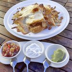 Crunchy cheesy nachos with assorted dips