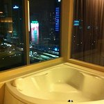 Nice bathtub with a view to the city