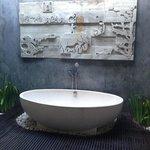 Amazing outdoor bath in master bedroom villa 5