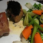 Lamb loin with black olive crumb, garlic cream
