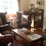 Photo is part of a very large lounge with comfortable chesterfield chairs and sofas.
