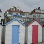Beach huts with hotel in background - that's how close you are!