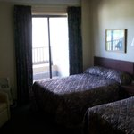 two double beds and 2 of 2 balcony doors