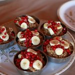 Delicious fresh breakfast - pomegranate seeds, bananas, millet