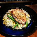 Pan-Seared Chicken Breast with a shucked corn & bacon cracklings risotto and house vegetables
