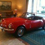 The large & unusual hotel lobby - complete with a mint condition Triumph Spitfire!