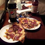 Our pizza and drinks at the hotel.