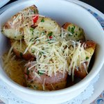 Potatoes with grated heese.