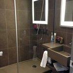 std bathroom, very nice! rain shower and hair dryer n toiletries included plus toilet is seperat