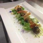 Dorset snail, wild garlic crumb, herb oil, pancetta crips