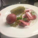 Pistachio cake, raspberry sorbet, raspberry salad, pistachio crumb