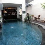 indoor pool under the staircase behind dining area