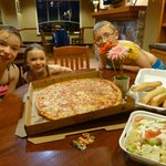 Enjoying some pizza at the hotel!
