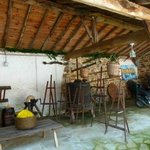 Shed with antique farm equipment and easels