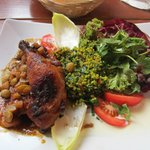 Chicken with grape-calvados sauce, tabouleh and salad