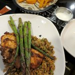 Sweet potato fries and grilled salmon with asparagus over herb-cooked couscous