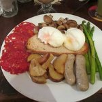 Huge spanish breakfast with your choice of eggs, toast, sauteed mushrooms, aspsragus, confit pot