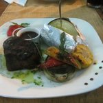 Tenderloin steak medium rare with jacket potato and grilled vegetables