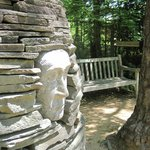 Stone face with bench
