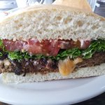 meat loaf sandwhich with carmelized onions on a ciabatta roll