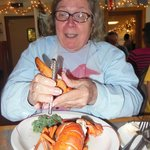 Carolyn has trouble cracking her lobster claws.