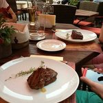 a couple of the Steaks, you can just about see the gleaming knives and forks